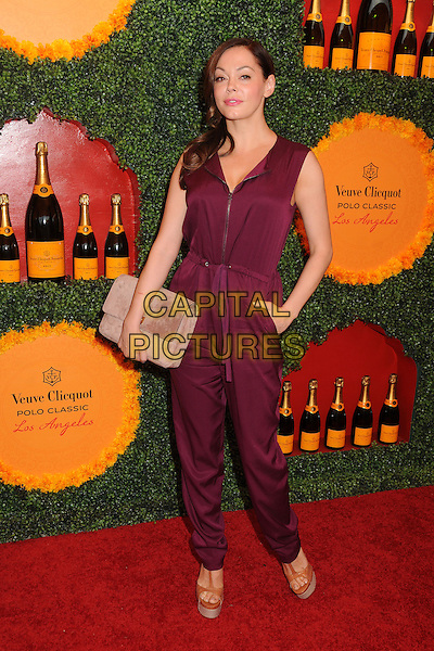 Rose McGowan.3rd Annual Veuve Clicquot Polo Classic held at Will Rogers State Historic Park, Pacific Palisades, California, USA, .6th October 2012..full length burgundy aubergine purple red maroon jumpsuit catsuit zip hand on hip  beige suede clutch bag brown sandals .CAP/ADM/BP.©Byron Purvis/AdMedia/Capital Pictures.