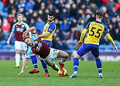 2nd February 2019, Turf Moor, Burnley, England; EPL Premier League football, Burnley versus Southampton; Charlie Taylor of Burnley is tackled by Shane Long of Southampton with Callum Slattery of Southampton close by