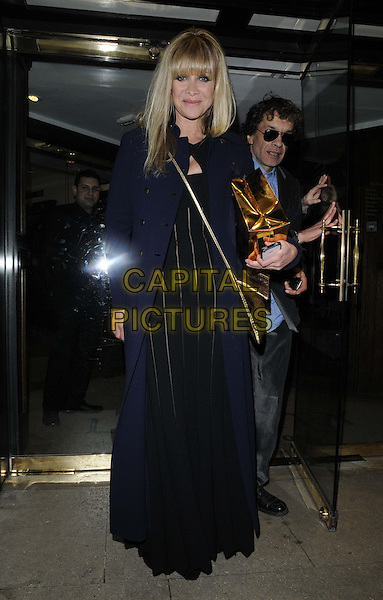 """Jo Wood.attended Jo Wood's """"Hey Jo"""" book launch party, Liberty London, Regent St., London, England..February 27th, 2013.full length blue long coat black dress door .CAP/CAN.©Can Nguyen/Capital Pictures."""