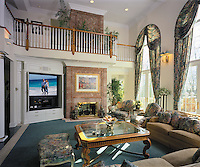 Remote Control Great Room With High Ceiling And Stone Fireplace