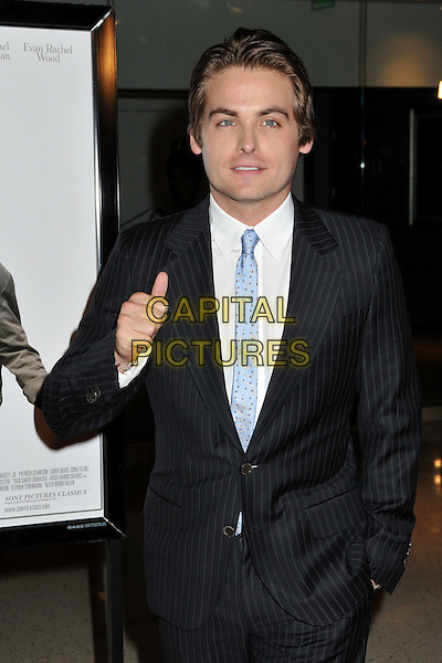 "KEVIN ZEGERS .""Whatever Works"" Los Angeles Premiere held at the Pacific Design Center, West Hollywood, CA, USA..June 8th, 2009.half length black suit blue tie hand in pocket thumb up.CAP/ADM/BP.©Byron Purvis/AdMedia/Capital Pictures."