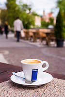 Ljubljana cafe culture. Coffee in one of the many cafes on the waterfront, Slovenia, Europe