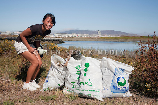 "Shorhon Gong from Aragon High School gives two thumbs up for full trash bags at Bayfront Park. Volunteers in the City of Millbrae participated in California Coastal Cleanup Day on 9/19/09. Participants cleaned up inland locations throughout the city as well as at Bayfront Park on the San Francisco Bay shoreline. The inland cleanup efforts were important because, according to the California Coastal Commission, ""past Coastal Cleanup Day data tell us that most (between 60-80 percent) of the debris on our beaches and shorelines comes from inland sources, traveling through storm drains or creeks out to the beaches and ocean. Rain or even something as simple as hosing down a sidewalk can wash cigarette butts, bits of styrofoam, pesticides, and oil into the storm drains and out to the ocean."" The California Coastal Cleanup Day (http://www.coastal.ca.gov/publiced/ccd/ccd.html) is sponsored by the California Coastal Commission and is a part of the International Coastal Cleanup organized by The Ocean Conservancy."