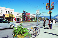 Vancouver, BC, British Columbia, Canada - Main Street Scene, Shops and Restaurants in Mount Pleasant Neighbourhood (Mt Pleasant Clock in midground)