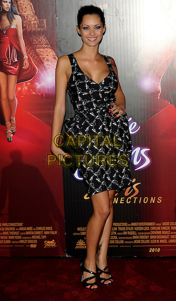 "JESSICA JANE CLEMENT.""Paris Connections"" Premiere, Vue Cinema, Leicester Square, London, England..September 2nd, 2010.full length black dress hand on hip clutch bag sleeveless white grey gray print.CAP/CJ.©Chris Joseph/Capital Pictures."