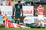 Mikael Antoine-Curier and Virgil Van Dijk in agony after a clash