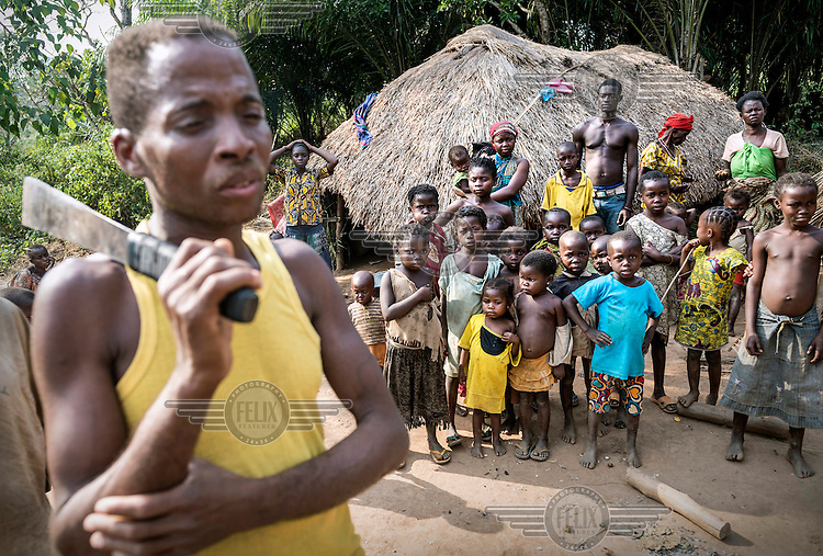A Christian man, armed with a machete, watches over a group of people who have fled into the forest from the predominantly Muslim village they lived in. In 2013 a rebellion by a predominantly Muslim rebel group Seleka, led by Michel Djotodia, toppled the government of President Francios Bozize. Djotodia declared that Seleka would be disbanded but as law and order collapsed the ex-Seleka fighters roamed the country committing atrocities against the civilian population. In response a vigillante group, calling themselves Anti-Balaka (Anti-Machete), sought to defend their lives and property but they then began to take reprisals against the Muslim population and the conflict became increasingly sectarian. French and Chadian peacekeeping forces have struggled to contain the situation and the smaller Muslim population began to flee the country.