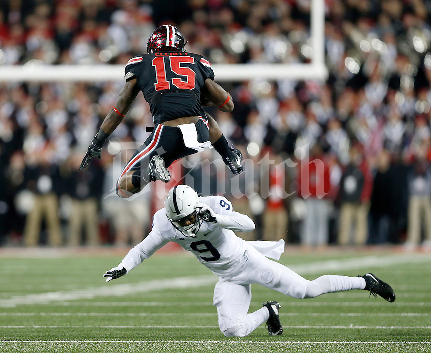 Ohio State Buckeyes running back Ezekiel Elliott (15) jumps over Penn State Nittany Lions safety Jordan Lucas (9) during the first quarter of the NCAA football game between the Ohio State Buckeyes and the Penn State Nittany Lions at Ohio Stadium on Saturday, October 17, 2015. (Columbus Dispatch photo by Jonathan Quilter)