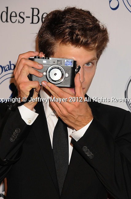 BEVERLY HILLS, CA - OCTOBER 20: Keegan Allen arrives at the 26th Anniversary Carousel Of Hope Ball presented by Mercedes-Benz at The Beverly Hilton Hotel on October 20, 2012 in Beverly Hills, California.
