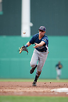 GCL Rays first baseman Russ Olive (24) flips the ball to the pitcher covering first base during a game against the GCL Red Sox on August 1, 2018 at JetBlue Park in Fort Myers, Florida.  GCL Red Sox defeated GCL Rays 5-1 in a rain shortened game.  (Mike Janes/Four Seam Images)