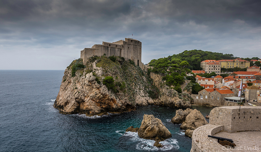 Photograph of the ocean port of Dubrovnik which is a walled city located within the southern part of Croatia and is situated along the Adriatic Sea. <br /> Built in the 16th century, It is known for its distinctive Old Town charm that has been encircled with massive stone walls to protect the city. <br /> Within the city walls are the St. Blaise Church, the Renaissance Sponza Palace, and the Gothic Rector&rsquo;s Palace which is now a history museum. Also located within the city are many small shops and restaurants.