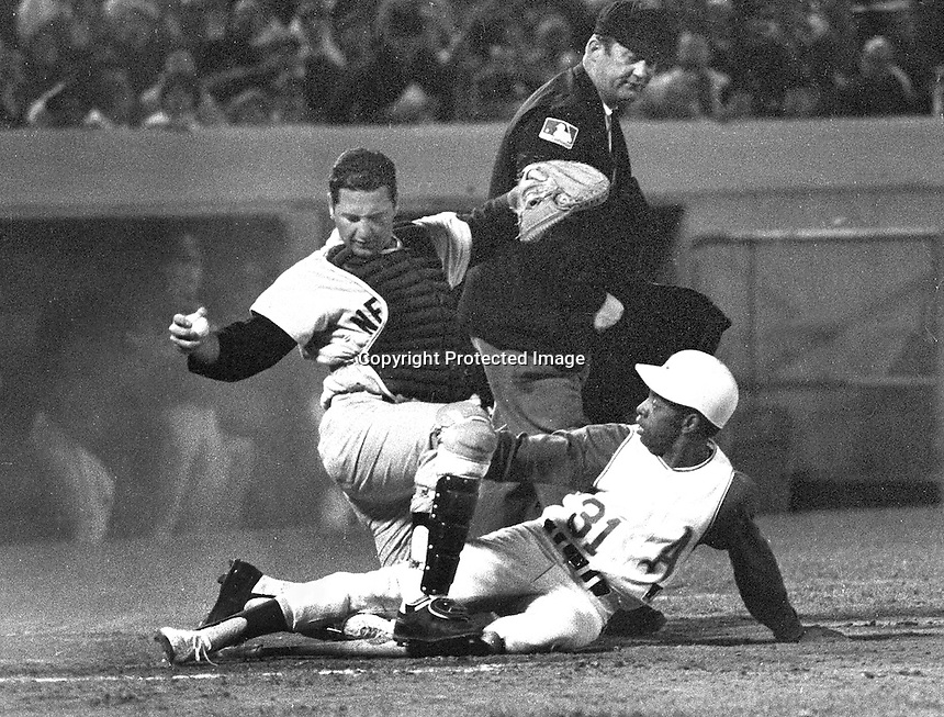 Oakland A's vs New York Yankee's...(1969) A's Jose Tartabull out at home by Yankee catcher Jake Gibbs. <br />(photo/Ron Riesterer)