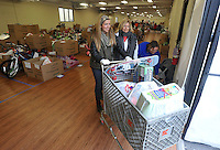 NWA Media/Michael Woods --12/17/2014-- w @NWAMICHAELW...Volunteers help distribute  food and toys for a local families Wednesday morning at the Salvation Army building in Springdale.  Several local volunteers helped distribute toys and food to local families for the holidays during the Salvation Army's annual event.