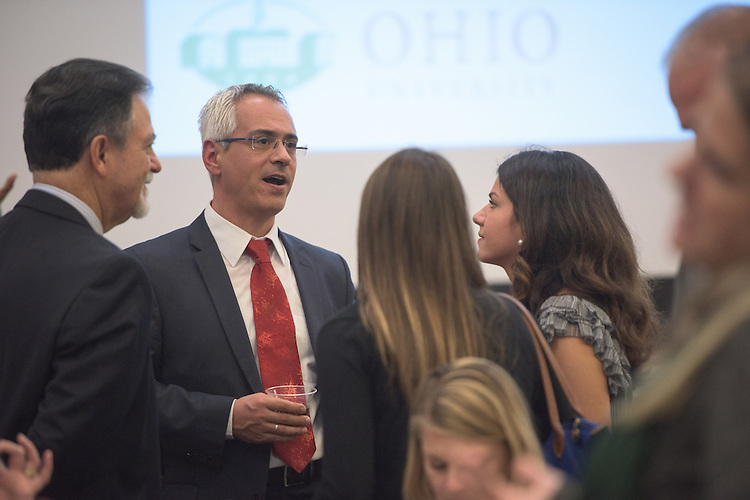 Dr. Nick Panagopoulos of the University of Alabama, speaks with attendees during a break in the 2016 Schey Sales Symposium held in Baker Center on November 3, 2016.