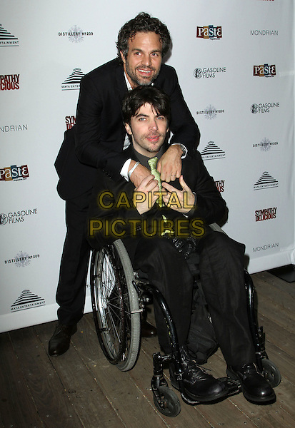 MARK RUFFLO & CHRISTOPHER THORNTON .Special event for the release of Sympathy for Delicious Held At The Sky Bar, Mondrian Hotel, West Hollywood, California, USA, 27th April 2011..full length  black suit green tie wheelchair hugging hug .CAP/ADM/KB.©Kevan Brooks/AdMedia/Capital Pictures.