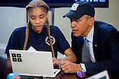"""United States President Barack Obama participates in an """"Hour of Code"""" event with middle-school students including Adrianna Mitchell in the Eisenhower Executive Office Building next to the White House in Washington, D.C., U.S., on Monday, December 8, 2014. The event is in honor of Computer Science Education Week. <br /> Credit: Andrew Harrer / Pool via CNP"""