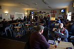 Gornal Athletic 4 Wisbech Town 2, 02/02/2013. Garden Walk Stadium, FA Vase 4th round. Supporters enjoying a pre-match pint in the social club at Garden Walk Stadium, prior to the FA Vase 4th round tie between Gornal Athletic from Dudley in the West Midlands and visitors Wisbech Town. Gornal, from the Midland Alliance and appearing for the first time at this stage of the tournament, defeated Wisbech, who play in the Eastern Counties League, by 4-2 after extra-time, after the visitors had lead two-nil after 10 minutes. The FA Vase was a nationwide, non-League English football tournament for semi-professional clubs and the winner of this tie played away at Bodmin Town in the next round. Photo by Colin McPherson.