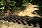 On the hill above the stone bridge in Torreya State Park in Florida is this sediment trap which is similar to a cattle guard in design but catches sediment laden water during heavy rain.  The trap reduces in the erosion to the road and the sedimentation in the stream at the base of the hill.