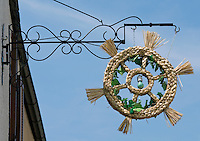 Austria, Lower Austria, UNESCO World Heritage Wachau, Duernstein: wreath of straw, sign that the wine growers have opened their Heurige pub