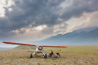 Pilot Dirk Nickisch with coyote air and his De-Havilland Beaver bush plane on tundra tires in the Brooks Range, arctic, Alaska. Hikers get a food resupply.