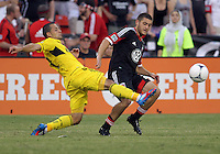 WASHINGTON, DC - AUGUST 4, 2012:  Chris Kolb (22) of DC United loses the ball to Dilly Duka (11) of the Columbus Crew during an MLS match at RFK Stadium in Washington DC on August 4. United won 1-0.