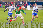 St Michaels/Foilmore's Sean Fogarty gathers up this pass from team mate Mark Griffin as St Mary's John Golden comes hot on his heals with John Alan O'Sullivan in Support.