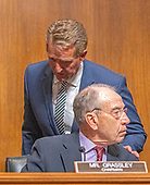 United States Senator Jeff Flake (Republican of Arizona), left, speaks with US Senator Chuck Grassley (Republican of Iowa), chairman, US Senate Committee on the Judiciary prior to a vote on the nomination of Judge Brett Kavanaugh to be Associate Justice of the US Supreme Court to replace the retiring Justice Anthony Kennedy on Capitol Hill in Washington, DC on Friday, September 28, 2018.  If the committee votes in favor of Judge Kavanaugh then it goes to the full US Senate for a final vote.  Flake voted to send the nomination to the US Senate floor but asked that the final vote be delayed pending an FBI check on the incident between Dr. Ford and Judge Kavanaugh when they were in high school.<br /> Credit: Ron Sachs / CNP<br /> (RESTRICTION: NO New York or New Jersey Newspapers or newspapers within a 75 mile radius of New York City)
