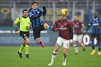 Nicolo Barella of FC Internazionale , Hakan Calhanoglu of AC Milan <br /> Milano 09/02/2020 Stadio San Siro <br /> Football Serie A 2019/2020 <br /> FC Internazionale - AC Milan <br /> Photo Andrea Staccioli / Insidefoto
