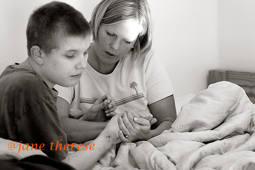 Jill comforts her son Danny's bruised body, while visiting him at Bancroft Behaviorial Center in Haddonfield, NJ. Jill and her husband Stacy, decided to remove Danny from the home because Danny had become hard to manage and increasingly more self abusive. Danny 15 who is severely autistic, has a younger brother Drew 10 living at home, who is also severely autisitc. Photo by Jane Therese