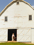 A horse trainer, Corrine, with a miniature  pony at the old, restored  barn at Kross Farm, Rhinebeck, New York.