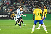 June 9th 2017, Melbourne Cricket Ground, Melbourne, Australia; International Football Friendly; Brazil versus Argentina; Lionel Messi of Argentina kicks the ball forward