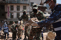 Nepali police force removes the rubble from a destroyed temple during the search operation at Kathmandu Durbar Square, Kathmandu, Nepal. May 03, 2015