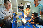 Students explore electricity in a school in the Sabra refugee camp in Beirut, Lebanon, run by the Department of Service for Palestinian Refugees of the Middle East Council of Churches. Most of the school's 148 students are Syrian refugees, but roughly one-third are Palestinian refugees and a few are poor children from the neighborhood. Lebanon hosts some 1.5 million refugees from Syria, and yet the government prohibits the establishment of large refugee camps, thus pushing many refugee families to search for housing in existing Palestinian refugee camps. This school is supported by the ACT Alliance.