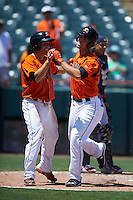Bowie Baysox Tucker Nathans (left) congratulates Drew Dosch (right) after a home run during a game against the Reading Fightin Phils on July 22, 2015 at Prince George's Stadium in Bowie, Maryland.  Bowie defeated Reading 6-4.  (Mike Janes/Four Seam Images)