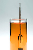 HYDROMETER MEASURES POTENTIAL ALCOHOL CONTENT<br /> (Variations Available)<br /> Hydrometer in California White Zinfandel 12.5 %<br /> The typical hydrometer measures three things:  specific gravity (S.G.), potential alcohol (P.A.), and sugar. As the alcohol concentration decreases the specific gravity increases and the hydrometer floats higher in the solution.