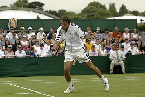 25 June 2003: British player Lee Childs (GBR) playing a backhand volley during his 2nd round defeat to Nadal on day 3 of the All England Lawn Tennis Championships at Wimbledon. Photo: Glyn Kirk/Action Plus...030625 tennis man men volleying