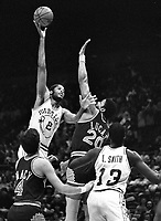 Warriors Jo Barry Carrol shoots over Suns Maurice Lucas and Kyle Macy...(1982 photo/Ron Riesterer)