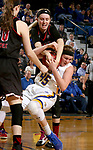 BROOKINGS, SD - MARCH 16:  Ellie Thompson #45 from South Dakota State University gets tied up with the ball by Kelly Smith #25 from Northern Illinois during their first round WNIT game Thursday at Frost Arena in Brookings.(Photo by Dave Eggen/Inertia)