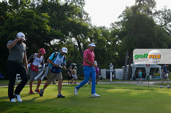 Ian Poulter (GBR) and Corey Conners (CAN) head down 6 during round 3 of the 2019 Charles Schwab Challenge, Colonial Country Club, Ft. Worth, Texas,  USA. 5/25/2019.<br /> Picture: Golffile | Ken Murray<br /> <br /> All photo usage must carry mandatory copyright credit (© Golffile | Ken Murray)