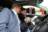 23-5-2014: Retired TD Jackie Healy-Rae, who was released from hospital in Tralee on Friday afternoon to travel the 100km round trip to vote for his grandson Johnny, on left,  is photographed excercising his right in a car outside Kilgarvan Polling Station on Friday with polling officer Tom O'Donnell.  Mr. Healy-Rae is recovering from an an operation on his knee which took place last Monday.<br /> Picture by Don MacMonagle