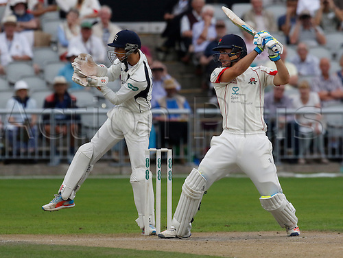 13.09.2016. Old Trafford, Manchester, England. Specsavers County Championship Division One Cricket.  Lancashire all-rounder Liam Livingstone cuts a ball to the offside as Middlesex wicket-keeper John Simpson looks on. Lancashire versus Middlesex. Middlesex were all out for 327 at lunch today.