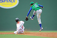 Shortstop Raul Mondesi (2) of the Lexington Legends has to jump high to grab the throw from the catcher but it's too late to prevent Kevin Heller (19) if the Greenville Drive from stealing second in a game on Sunday, August 18, 2013, at Fluor Field at the West End in Greenville, South Carolina. Lexington won the first game of a doubleheader, 5-0. (Tom Priddy/Four Seam Images)