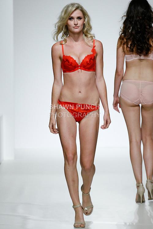 Model walks runway in lingerie from Bradelis New York during Lingerie Fashion Week Spring Summer 2014, at the Metropolitan Suite on August 1, 2013.