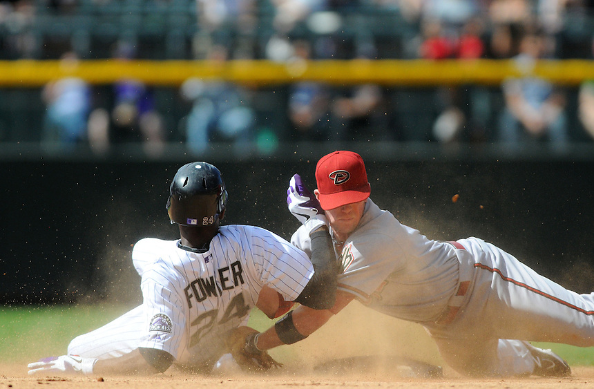 05 SEPTEMBER 2011:  Rockies center fielder Dexter Fowler (24) is safe at second stretching a double, as Diamondbacks second baseman Aaron Hill (2) dives back for the tag  during a regular season game between the Arizona Diamondbacks and and the Colorado Rockies at Coors Field in Denver, Colorado.  The Diamondbacks beat the Rockies 10-7.  *****For Editorial Use Only*****