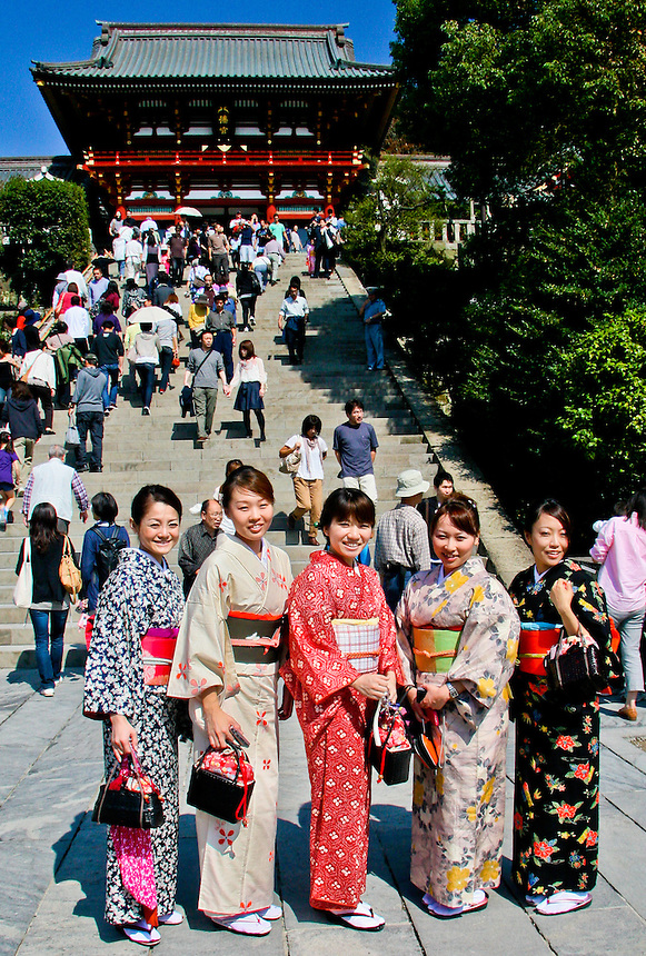 5 girls in Kimono`s pose for photographs while visiting Kamakura`s Tsurugaoka Hachiman-gu temple.