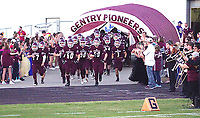 Photo by Randy Moll<br /> The Pioneers take to the field to play the visiting Berryville Bobcats on Friday night in Gentry.