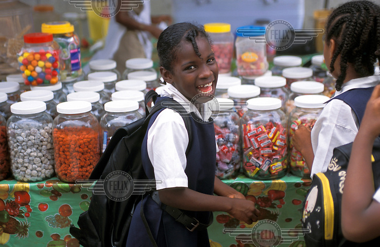 School children at a sweet stall.