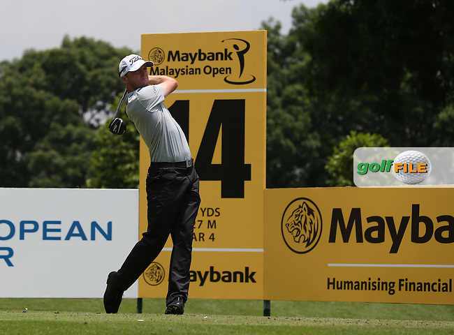 Michael Hoey (NIR) takes a driver to the shorten 14th which was the start of a poor run in with bogeys on the 14th, 15th and 16th during Round Three of the 2014 Maybank Malaysian Open at the Kuala Lumpur Golf & Country Club, Kuala Lumpur, Malaysia. Picture:  David Lloyd / www.golffile.ie