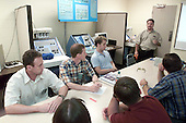 From the left, Soyuz 5 Commander Sergei Zalyotin, Soyuz 5 Flight Engineer Frank DeWinne and Soyuz 5 Nominated Space Flight Participant Lance Bass, a member of the pop singing group 'N Sync, listen to a briefing on fire control conducted by emergency training instructor David Levy (standing in background) at the Lyndon B. Johnson Space Center in Houston, Texas on August 27, 2002. The class room session came during training and familiarization at the Johnson Space Center (JSC).  Zalyotin represents Rosaviakosmos and De Winne is affiliated with the European Space Agency (ESA). .Credit: NASA via CNP