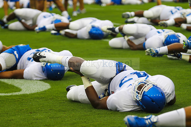 UK players stretch during practice on Fan Day on Friday, August, 9th, 2013 at Commonwealth Stadium in Lexington, KY. Photo by Michael Reaves | Staff